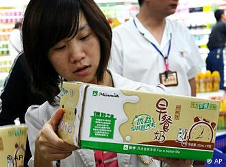 A Chinese woman looks at the milk products on sale at a supermarket