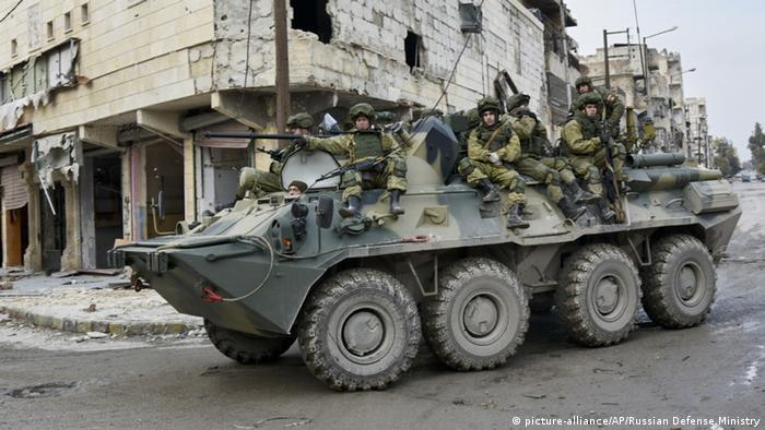Russian soldiers in liquefied Aleppo