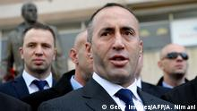 Kosovo former Prime Minister Ramush Haradinaj talks to the media after paying homage to the statue of ex-Kosovo Liberation Army (KLA) commander Zahir Pajaziti in Pristina on November 30, 2012. Haradinaj arrived in Pristina to a jubilant welcome after the UN court cleared him from charges of war crimes committed during the 1998-1999 conflict.AFP PHOTO/ARMEND NIMANI (Photo credit should read ARMEND NIMANI/AFP/Getty Images)