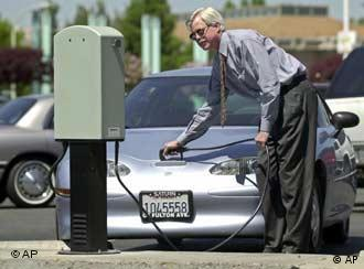A man charges up an electric car in California