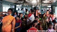 ARCHIV 2013 +++ Indian women passengers sit in a ladies compartment as the local train departs from Sealdha rail station on the day of the announcement of the Rail Budget 2013 in Eastern Indian city of Calcutta on 26 February 2013. .Focusing on safety for millions of travelers and financial stability Indian Railway Minister Pawan Kumar Bansal presented budget details for his ministry and announced next generation e-ticketing system that will improve the speed of online ticket booking and to increase the number of women in the Railway Police Force EPA/PIYAL ADHIKARY +++(c) dpa - Bildfunk+++ | train compartment women