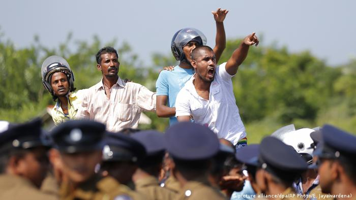Protesting villagers shout slogans earlier this year