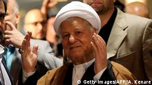 Iranian former president and head of the Expediency Council, Akbar Hashemi Rafsanjani gestures as he registers his candidacy for the upcoming Assembly of Experts elections at the interior ministry in Tehran on December 21, 2015. The 86-member Assembly's role is to monitor the work of the supreme leader, currently Ayatollah Ali Khamenei. The poll will coincide in February 2016 with parliamentary elections, which could see more moderates and reformists chosen on the back of Iran's recent nuclear deal with world powers. AFP PHOTO / ATTA KENARE / AFP / ATTA KENARE (Photo credit should read ATTA KENARE/AFP/Getty Images)