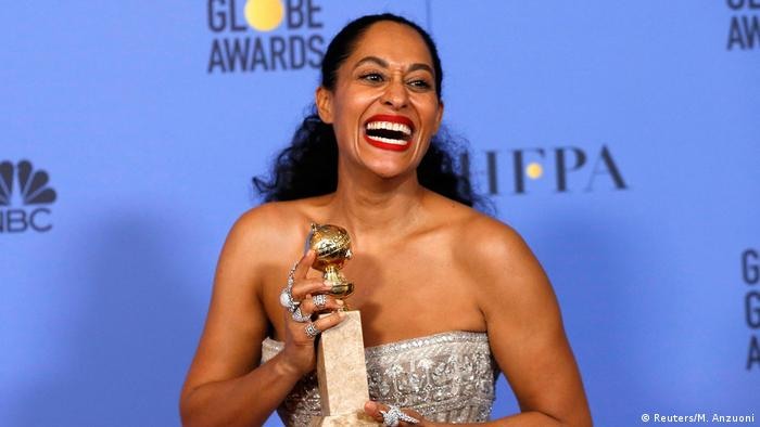 Tracee Ellis Ross holding Golden Globe for best actress in a TV comedy (Reuters/M. Anzuoni)