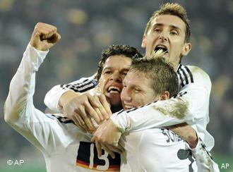 Michael Ballack celebrates his goal with Bastian Schweinsteiger and Miroslav Klose