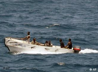 Somali pirates head for shore following a 2008 incident