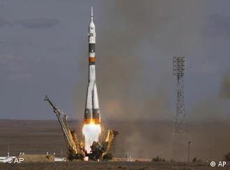 The Soyuz-FG rocket booster with Soyuz TMA-13 space ship carrying a new crew to the international space station (ISS) blasts off from the Russian leased Baikonur Cosmodrome, Kazakhstan, Sunday, Oct.12, 2008. The Russian rocket carries U.S. space tourist Richard Garriott, U.S. astronaut Michael Fincke, and Russian cosmonaut, commander of the mission Yury Lonchakov. (AP Photo/Dmitry Lovetsky)