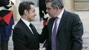 French President Nicolas Sarkozy, left, welcomes Britain's Prime Minister Gordon Brown before a crisis summit at the Elysee palace in Paris, Sunday Oct.12, 2008.