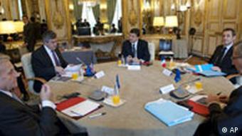 European Central Bank President Jean-Claude Trichet, Britain's Prime Minister Gordon Brown, European Commission President Jose Manuel Barroso, France's President Nicolas Sarkozy and President of Eurogroup Jean-Claude Juncker, from left, meet at the Elysee Palace in Paris, Monday Oct. 12, 2008.