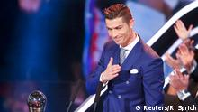 Football Soccer - FIFA Awards Ceremony - Men's Player of the Year - Zurich, Switzerland - 09/01/17. Cristiano Ronaldo celebrates with the trophy. REUTERS/Ruben Sprich TPX IMAGES OF THE DAY