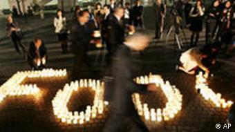 Participates spell out the word food with candlelight lanterns, as they attend an event to raise public awareness on the fight against world hunger, in Yokohama, near Tokyo Monday, Oct. 22, 2007. (AP Photo/Shizuo Kambayashi)