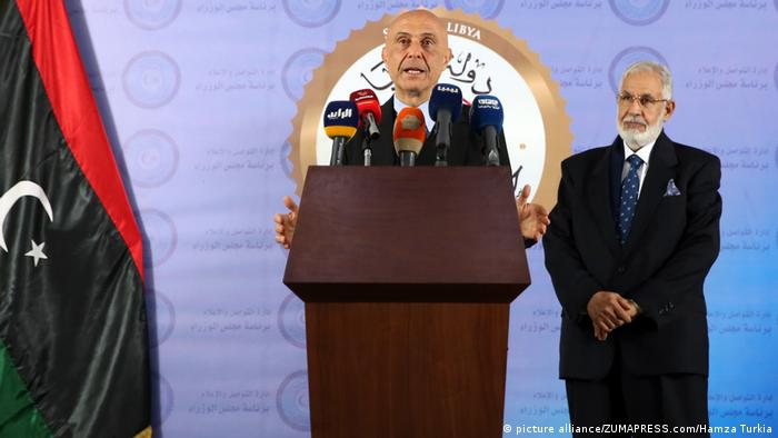 Italian interior minister Marco Minniti (left) speaks during a press conference in Tripoli