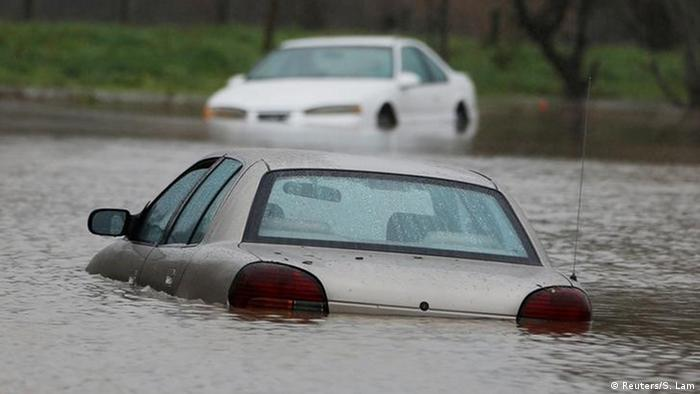 Vehicles submerged in flood waters are seen during a winter storm in Petaluma, California (Reuters/S. Lam)
