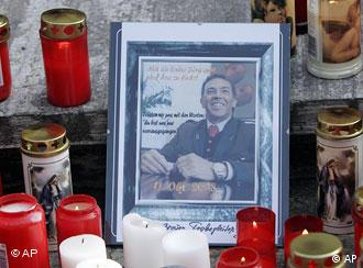 Candles and a photograph of Austrian politician Joerg Haider