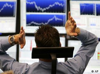 A broker is seen at the stock market in Frankfurt, central Germany, Monday, Oct. 13, 2008.