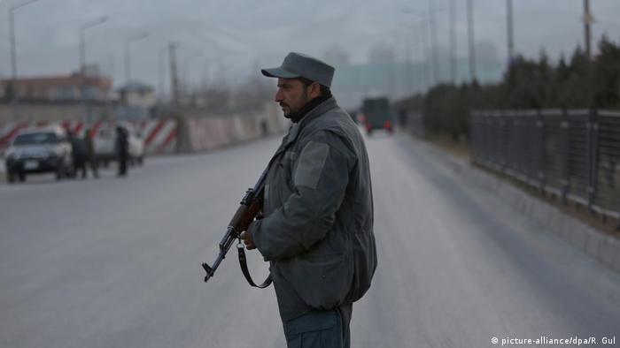 A policeman stands guard at the site of the attack