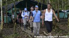 FARC Demobilization Camp. FARC guerrilla commander Pedro (R) walks with members of the United Nations Observation Mission during thier visit at the Front 34 Alberto Martinez encampment in the Vegaez municipality, Antioquia department, Colombia on January 2, 2017. Colombia's Congress passed a law granting an amnesty to the marxist FARC rebels as part of the country's peace deal, a development the government hailed as historic. / AFP / STR / RAUL ARBOLEDA (Photo credit should read RAUL ARBOLEDA/AFP/Getty Images)