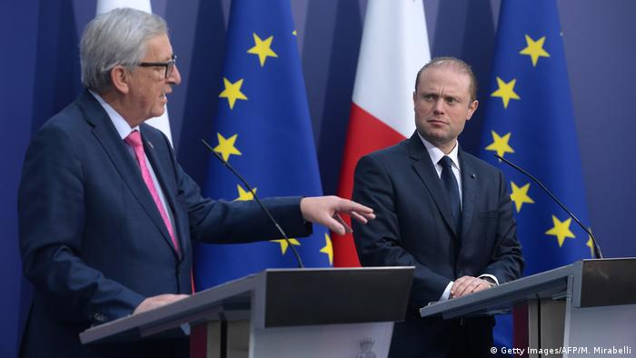 European Commission president Jean-Claude Juncker (L) holds a press conference on January 11, 2017 with Malta's Prime Minister Joseph Muscat in Valletta, Malta