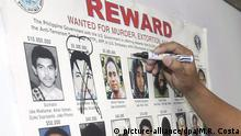 ARCHIV 2007 *** epa00907683 Philippine Armed Forces Chief Gen. Hermogenes Esperon Jr., crosses out a photo of Abu Sayyaf leader Khaddafy Janjalani on a wanted poster, during a press conference announcing the death of the Muslim militant at the Armed Forces' headquarters in Quezon city's Manila ,Philippines on Saturday 20 January 2007. The Armed Forces of the Philippines (AFP) on Saturday confirmed that the corpse recovered in the town of Jolo in Sulu province, southern Philippines last year was that of slain Abu Sayyaf Group (ASG) leader Khadaffy Janjalani. Janjalani was on a US list of most wanted terrorists and had $5 million bounty on his head. He was wanted for a series of beheadings, bombings and abductions in Mindanao. EPA/MELYN R. ACOSTA |