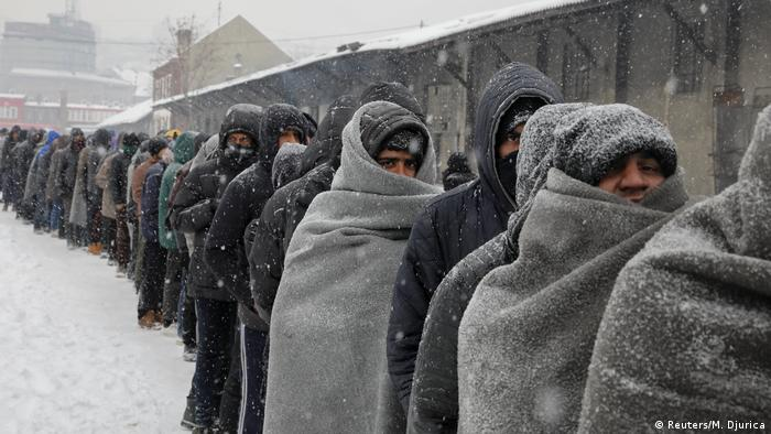 Refugees in line for a meal in the snow in Serbia (Reuters/M. Djurica)