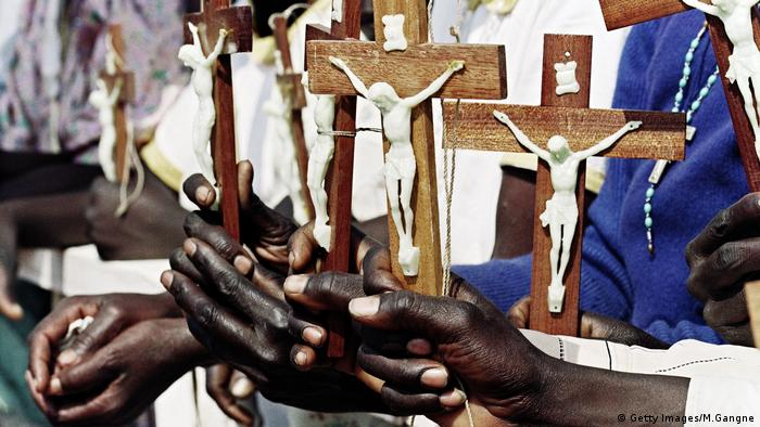 African Christians holding crucifixes