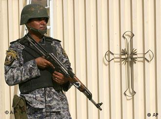An Iraqi soldier stands guard outside the old easter Church, in Dora district, Baghdad, Iraq