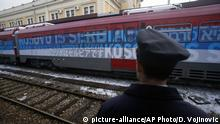 A railroad worker stands by the first train decorated with letters that read Kosovo is Serbian written in twenty languages departing from the Belgrade to Mitrovica, Kosovo at Belgrade's railway station, Serbia, Saturday, Jan. 14, 2017. Serbia has launched a railway link to Serb-dominated northern Kosovo despite protests from authorities in Pristina who described the move as a provocation and an aggressive violation of Kosovo's sovereignty. (AP Photo/Darko Vojinovic)  