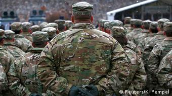 US army soldiers attend an official welcoming ceremony for US troops deployed to Poland as part of NATO buildup in Eastern Europe, in Zagan, Poland, on January 14, 2017