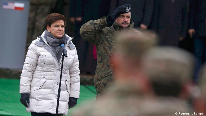 Polish Prime Minister Beata Szydlo (L) at a welcoming ceremony for US troops in Poland as part of NATO build-up, Zagan, Poland, January 14, 2017