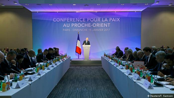 French Foriegn minister Jean-Marc Ayrault speaks onstage at the 2017 Paris summit (Reuters/T. Samson)