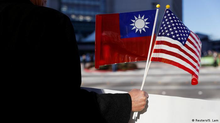 Protester holds Taiwanese and US flags