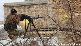 A Free Syrian Army member attacks IS positions in Aleppo, Syria