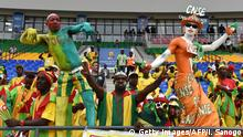16.01.2017+++Oyem, Gabun+++ Ivory Coast and Togo supporters cheer for their teams ahead of the 2017 Africa Cup of Nations group C football match between Ivory Coast and Togo in Oyem on January 16, 2017. / AFP / ISSOUF SANOGO (Photo credit should read ISSOUF SANOGO/AFP/Getty Images)