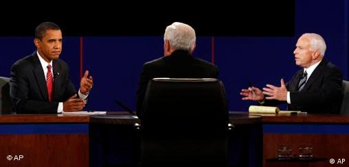 Democratic presidential candidate Sen. Barack Obama, D-Ill., and Republican presidential candidate Sen. John McCain, R-Ariz., exchange respones as Debate moderator Bob Schieffer listens during a presidential debate at Hofstra University in Hempstead, N.Y., Wednesday, Oct. 15, 2008. (AP Photo/Ron Edmonds)
