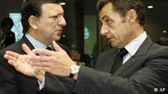 French President Nicolas Sarkozy, right, shares a word with European Commission President Jose Manuel Barroso
