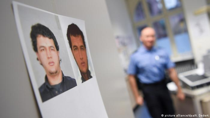 Pictures of Anis Amri hang on a wall at a police station