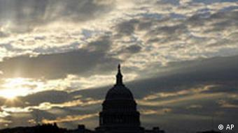 The sun rises over the U.S. Capitol on Wednesday Oct. 15, 2008.