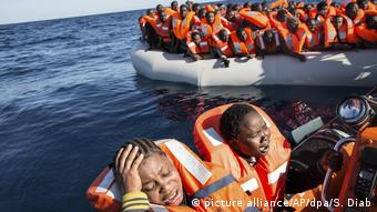 Overfilled boat full of migrants on the Mediterranean