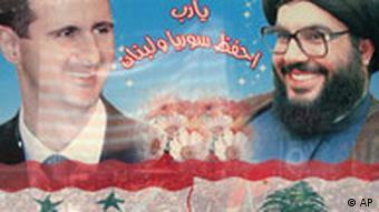 A poster shows Syrian President Bashar Assad, left, and Lebanese Hezbollah leader Hassan Nasrallah