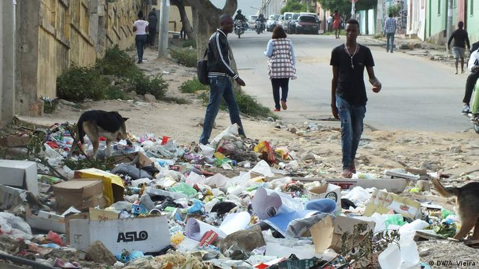 A dog rummages through litter in a street of the Angolan city of Lubango.
