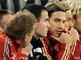 Germany's Torsten Frings, center, watching from the bench during the World Cup group 4 qualifying soccer match between Germany and Wales in Moenchengladbach, Germany, on Wednesday