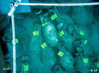 In this image released by the Valencia regional government on Monday, Nov. 13, 2006, some of the hundreds of well-preserved clay amphoras or two-handled jars, used in this case to hold fish sauce that was a prized condiment for wealthy Romans, are seen in waters off Alicante, eastern Spain. Marine archeologists said Monday they have made a dazzling find in waters off Spain, the shipwreck of a 1st-century vessel that was taking delicacies back to the wealthiest of the wealthy under the Roman Empire. (AP Photo/Valencia Regional Government, HO)