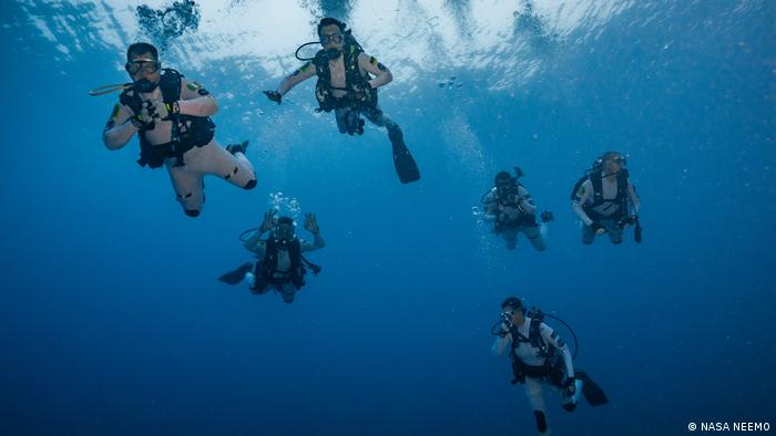 Divers on an underwater mission