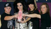 German band Tokio Hotel members show their award for best new artist of the year the 2008 during the MTV Latin Video Music Awards at the Telmex Auditorium in Guadalajara, Mexico, Thursday Oct. 16, 2008. (AP Photo/Alexandre Meneghini)