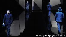 Models walk the runway at the Giorgio Armani show during Milan Men's Fashion Week- Giorgio Armani (Getty Images/V.Z. Celotto)
