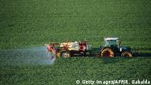 A farmer sprays a chemical fertilizer on his wheat field in Trebons-sur-la-Grasse, southern France, on April 20, 2015. The fertilizer, containing a trio of chemicals including nitrogen, phosphate and potassium (NPK), may alter the groundwater, making it non-potable. AFP PHOTO / REMY GABALDA (Photo credit should read REMY GABALDA/AFP/Getty Images)