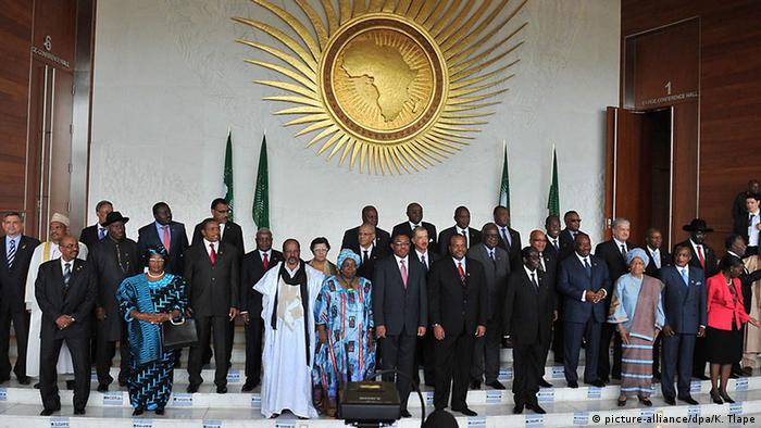 AU's heads of state and government gathered under the AU logo for a family picture.