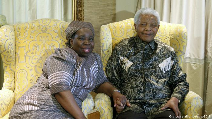 Nkosazana Dlamini-Zuma sits next to former President Nelson Mandela holding his right hand in this picture from 2012.