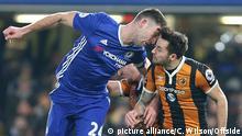 22 January 2017 - Premier League Football - Chelsea v Hull City Gary Cahill of Chelsea and Ryan Mason of Hull City crack heads as they jump for a header Photo: Charlotte Wilson |