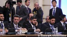 23.01.2017 **** Mohammad Alloush (C), the head of the Syrian opposition delegation, attends Syria peace talks in Astana, Kazakhstan January 23, 2017. REUTERS/Mukhtar Kholdorbekov
